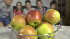 Kids takes apples from the bowl by Sheyno,crane, tracking ,close up. Stock Footage