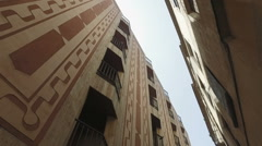Steadycam moving view of old builings in gothic district Stock Footage