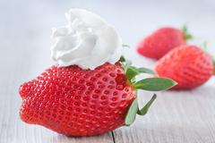 Strawberry And Whipped Cream Stock Photos