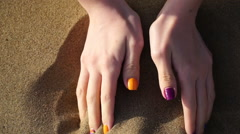 footage woman walking on the beach and holding a sand - stock footage