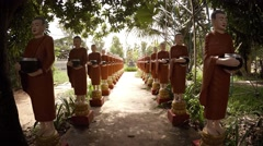 Rows of of sculptures portraying Buddhist monks. Cambodia Stock Footage