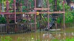 A huge waterwheel on the River. Cambodia, Siem Reap Stock Footage