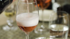 Pouring rose wine in a glass Stock Footage