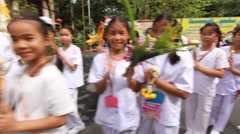 Visaka Bucha day. Students hold flower sacrifice. Buddhist temple in bangkok Stock Footage