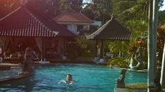 Woman swimming in the beautiful pool Stock Footage