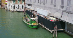 Venice restoration reconstruction architectural repair boat works. - stock footage