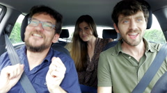 Three happy cool people in car dancing going in vacation 4K - stock footage