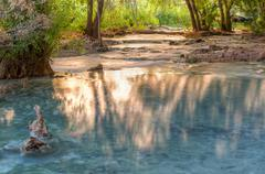 Golden Shadows and Turquoise Creek - stock photo