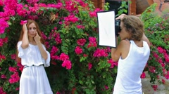 Photoshooting of beautiful woman Stock Footage