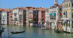 Venice Italy canal canal gondola gondolas Venezia pan panning tour sun summer Stock Footage