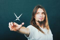 Hairstylist with scissors in hand - stock photo