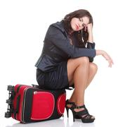 Full length young business woman to late red travel bagd - stock photo