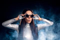 Surprised Woman in Silver Costume and Steampunk Glasses - stock photo