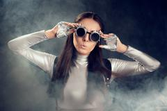 Surprised Woman in Silver Costume and Steampunk Glasses Stock Photos