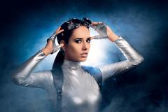 Woman in Silver Costume and Steampunk Glasses - stock photo
