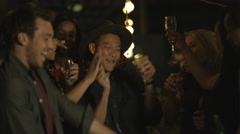 4K Happy mixed ethnicity group of friends drinking & dancing at rooftop party Stock Footage