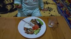 Cute child eats fresh peapod Stock Footage