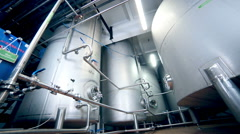 Shiny stainless steel tanks for alcohol distillation and storage - stock footage