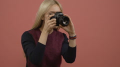Glamour blonde woman photographer holding a digital camera and shooting - stock footage