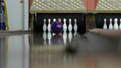 A ball hits pins in bowling alley - stock footage