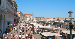 Italian touristic souvenirs flea marketplace Venice, San Marco. Crowd tourists Stock Footage
