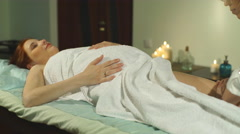pregnant woman doing a foot massage - stock footage