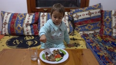 Child eats with zest Stock Footage