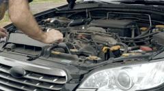 Auto mechanic visually examines car motor engine - stock footage