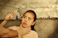 Abused girl by a male adult Stock Photos