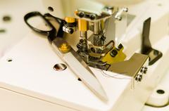 Close up of most important part of sewing machine, needle and thread. Scissor Stock Photos