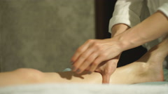 pregnant woman doing foot massage - stock footage
