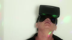 VR: A man follows the action inside his virtual reality headset (Variation) Stock Footage