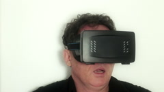 Virtual Reality VR: Man tries out VR headset, reacts to actual vr video Stock Footage
