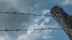 Barbed Wire And Clouds Stock Footage