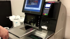 Close up of man taking receipt at self-check out counter - stock footage