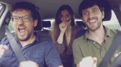 Woman singing in car with two male friends going in vacation in summer retro Stock Footage