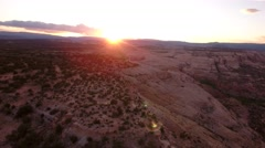 An aerial dolly shot of beautiful desert cliffs and sunset landscape - stock footage