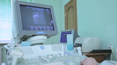 Doctor using the ECHO ultrasonography explores vessels in humans Stock Footage