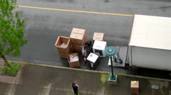 Top shot of movers unloading electric home appliances Stock Footage