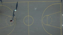 4k aerial shoot going down of a basketball filed and two players Stock Footage