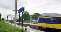 Public transport in the Netherlands, train arrival at train station, 4K - stock footage