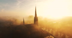 The camera flies towards a church covered in fog Stock Footage
