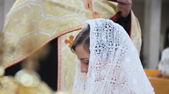 Bride in a scarf in the church Stock Footage