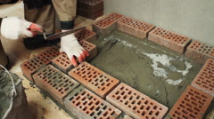 Installation of a wood stove. Laying of the foundation under a stove from bricks - stock footage