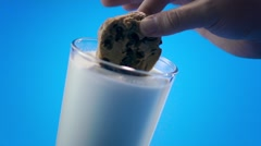 Dunking A Cookie in Milk - stock footage