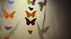 Butterflies, which cut foil hang on thread - stock footage