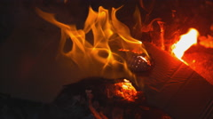 Extreme close up on open flame. Water douses it from the right. Slow motion. Stock Footage