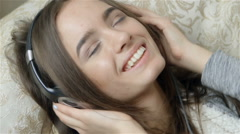 Attractive Dark-haired Woman Listening To Music - stock footage