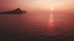 Tilt up shot of orange ocean during sunset Stock Footage