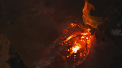Extreme close up on open flame. Water douses it from the left. Slow motion. Stock Footage